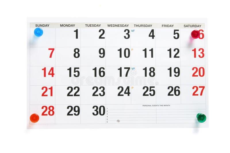 Pagina del calendario con gli a pressione fotografia stock