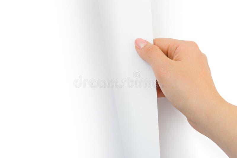 Pagina di carta di giro della mano immagine stock