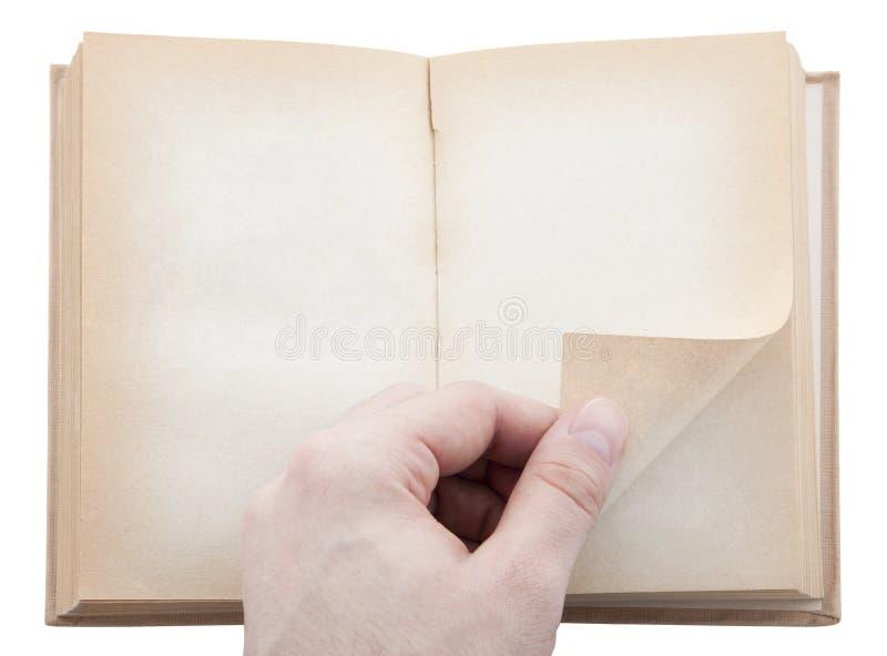 Pagina di giro del libro della mano immagine stock