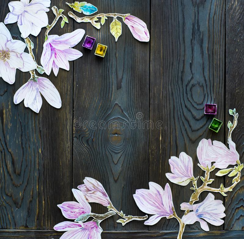 Pagina i fiori della magnolia dell'acquerello sopra backgr di legno rustico scuro fotografia stock