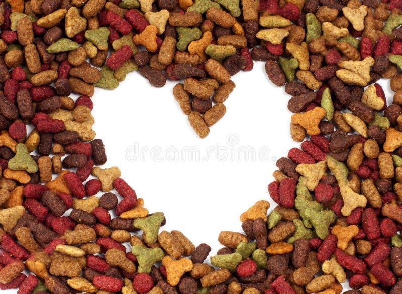Pagina il cuore di alimento per animali domestici per uso del fondo immagine stock