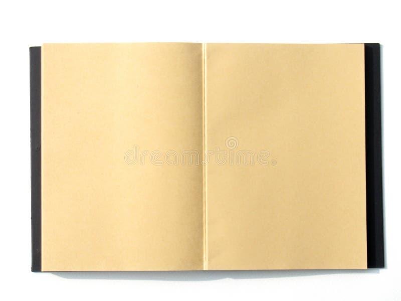 Pagina marrone in bianco aperta del taccuino fotografia stock libera da diritti
