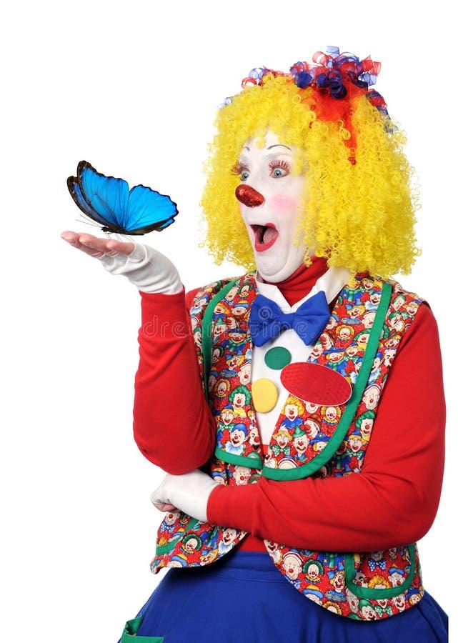 Pagliaccio che tiene farfalla blu immagini stock libere da diritti
