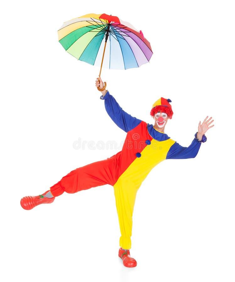 Pagliaccio felice con l'ombrello fotografia stock libera da diritti