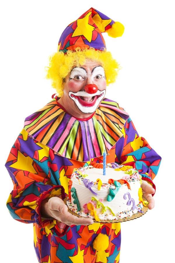 Pagliaccio isolato con la torta di compleanno fotografia stock libera da diritti