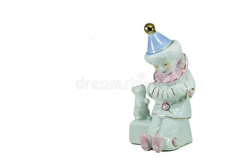 Pagliaccio triste isolato della figurina della porcellana fotografie stock