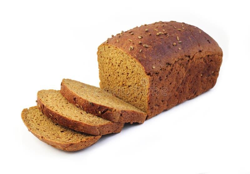 Pagnotta del pane di segale con le fette immagine stock libera da diritti