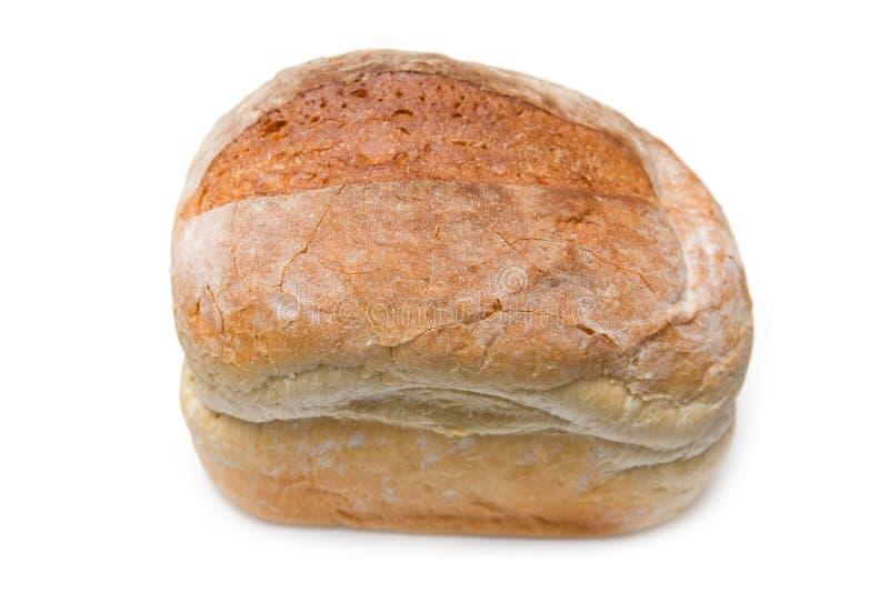 Pagnotta di pane bianca isolata su bianco. immagine stock libera da diritti