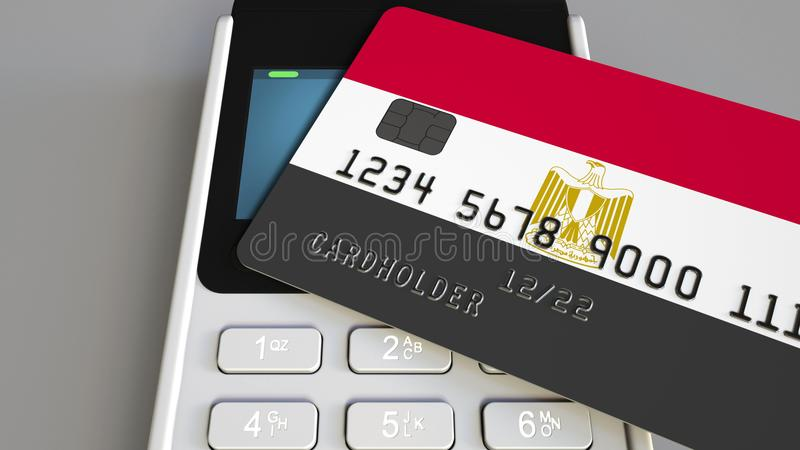 Pago o terminal de la posición con la tarjeta de crédito que ofrece la bandera de Egipto Comercio o sistema bancario al por menor imagen de archivo libre de regalías