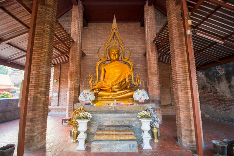 The Pagoda and Buddha Status at Wat Yai Chaimongkol, Ayutthaya,. Aligned Sitting Buddha Statues and Buddha Status at Wat Yai Chaimongkol, Ayutthaya, Thailand royalty free stock photos