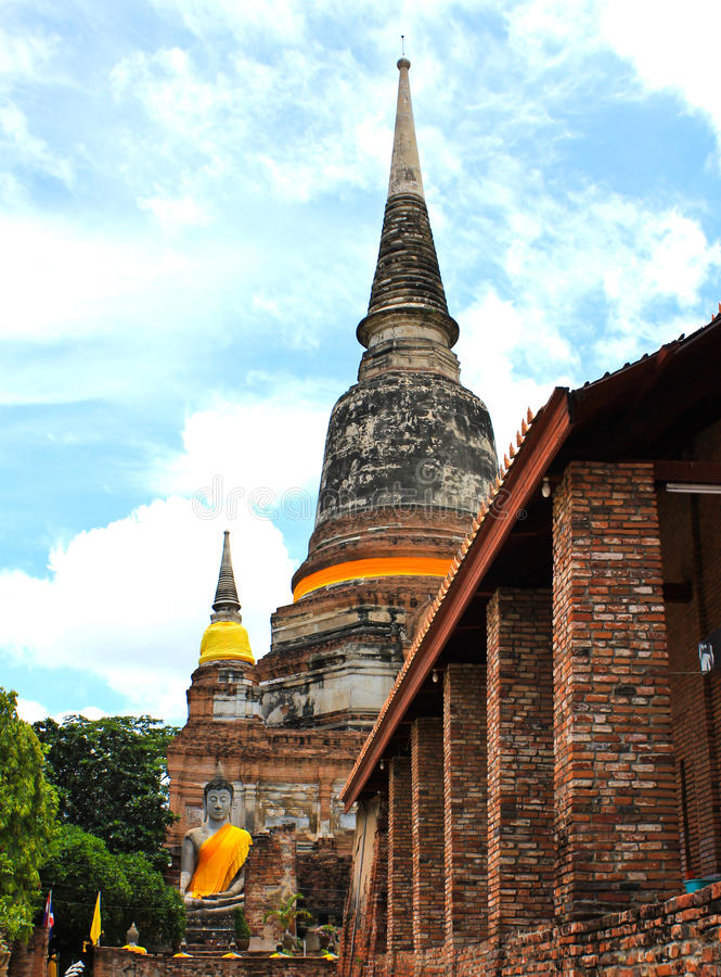 Pagoda and Buddha Status at Wat Yai Chaimongkol. Ayutthaya, Thailand royalty free stock photography