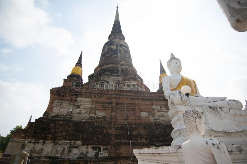 Pagoda and Buddha Status at Wat Yai Chaimongkol, Ayutthaya. Thailand stock photo