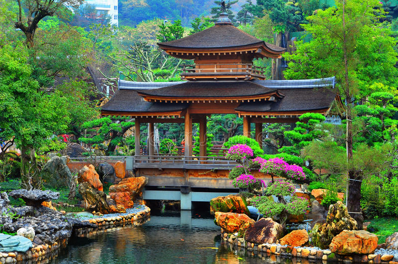 Pagoda in chinese zen garden. Pagoda in front of a pond in a beautiful chinese garden surrounded with exotic colors of spring foliage