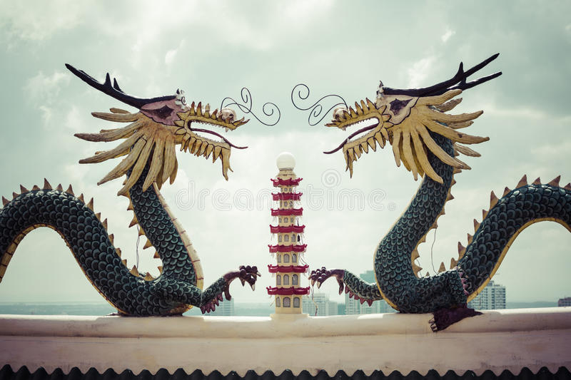Pagoda and dragon sculpture of the Taoist Temple in Cebu, Philip. Pines stock photos