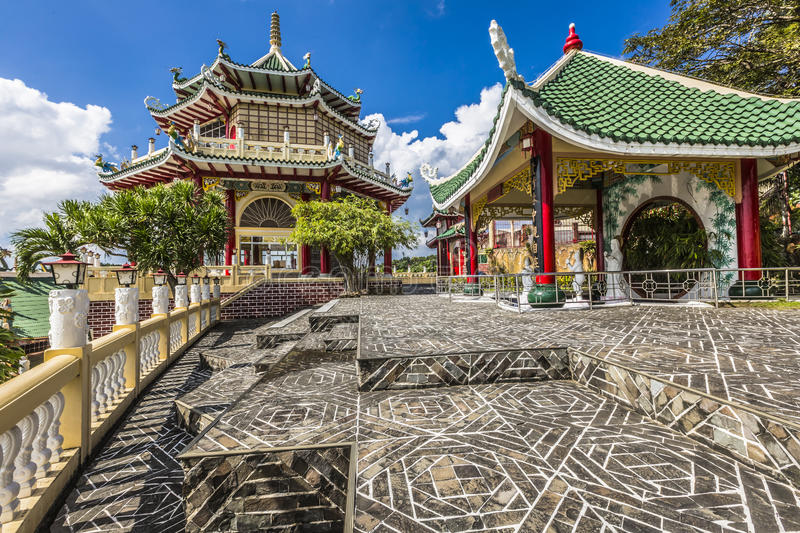 Pagoda and dragon sculpture of the Taoist Temple in Cebu, Philip. Pines stock photography