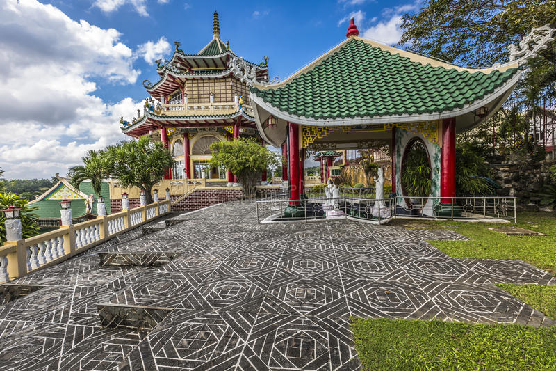 Pagoda and dragon sculpture of the Taoist Temple in Cebu, Philip. Pines stock photo