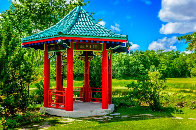 Pagoda feature in public park.  Number Two. Pagoda or gazebo feature set in public park.  A tranquil woodland setting for a peaceful day in a natural environment royalty free stock images