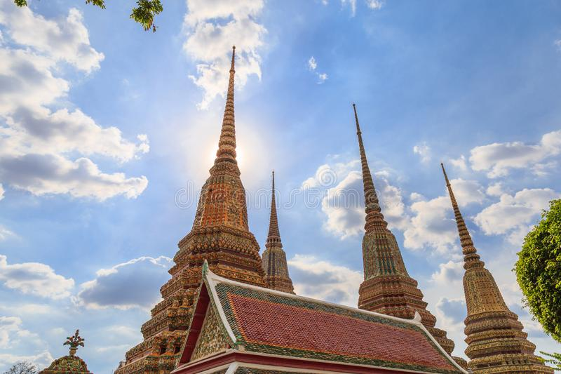 Pagoda and pavilion against a clouds and blue sky, architecture. Of Buddhism in Wat Pho Bangkok Thailand stock photography