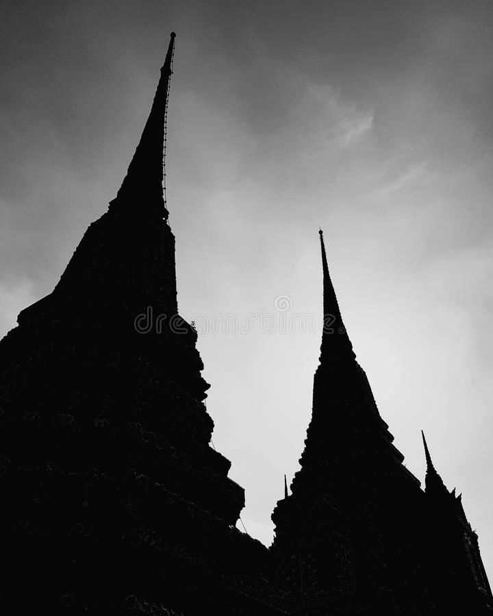 Pagoda religious architecture at Buddhist temple. Stupa, religion, buddhism, traditional, culture, traveling, tourism, thailand, ancient, historic, black-and stock images