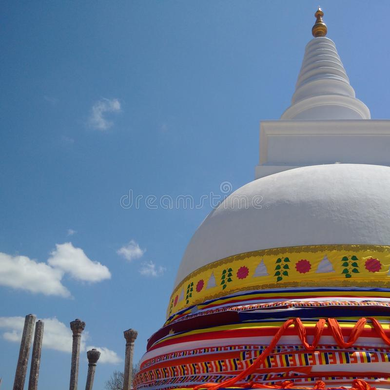 Pagoda Sthupa with ancient stone architecture ruins and blue sky stock photo