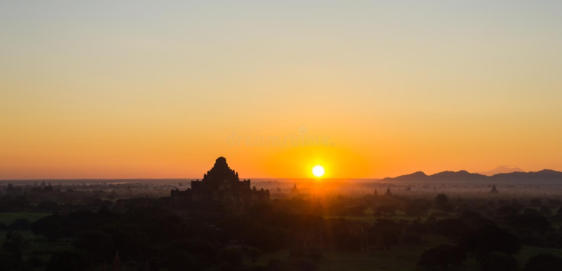 Pagoda and sunrise at Misty Bagan, Myanmar stock photos