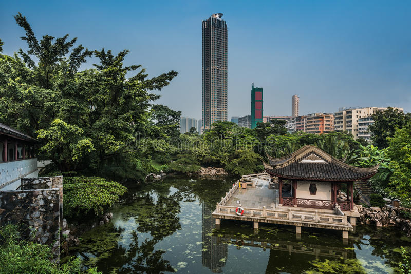 Pagoda temple pond Kowloon Walled City Park Hong Kong. Pagoda temple by pond at Kowloon Walled City Park in Hong Kong stock images