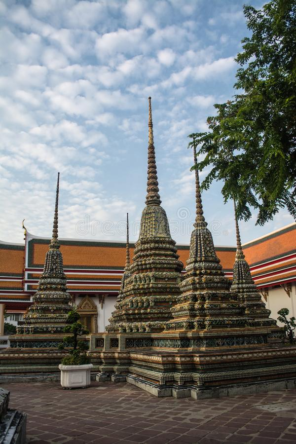 Pagoda is in Wat Pho that was named as the temple of the pagoda. Or chedi that are decorated with yellow glaze or glazed tiles or dark blue royalty free stock photos
