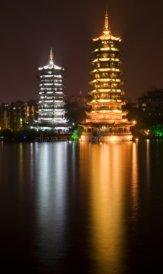 Pagodas Guilin China. Night shot of Gold and Silver Pagodas, Guilin, Guangxi, China. Reflections in Lake. Guilin is famous for its city tour through two rivers stock photo