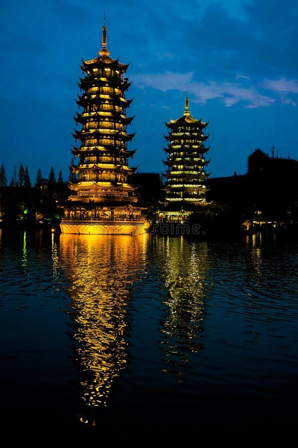 Pagodas Guilin, China, Sun and Moon Pagodas, Guangxi, China. Illuminated pagodas reflecting in water, Guilin, China stock photo