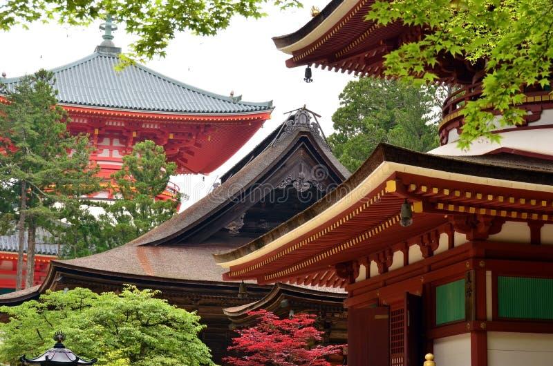 Pagodas of Mount Koya. Red wooden pagodas amongst lush summer greenery on Mount Koya, Japan stock photos