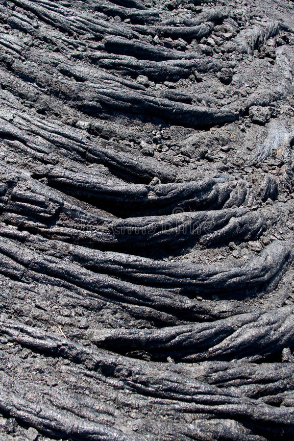 Pahoehoe Lava Detail. Vertical detail of pahoehoe lava on Kilauea volcano, Hawaii royalty free stock images