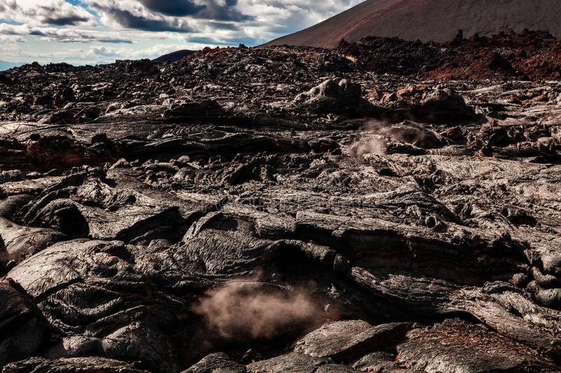 Rough surface of frozen lava after Mauna Loa volcano eruption, Hawaii, USA. Pahoehoe lava field on Hawaii`s Big Island. Chain of Craters Road, Volcano National stock images