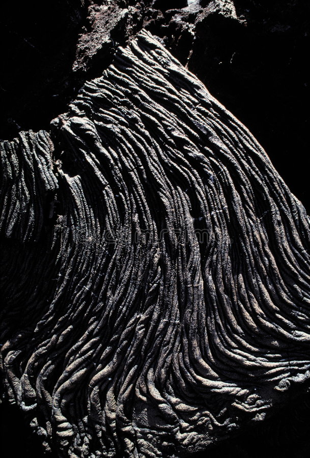 Pahoehoe lava flow. A Pahoehoe lava flow on James Island, part of the Galapagos Islands of Ecuador. This lava has a thick, rope-like texture stock photos