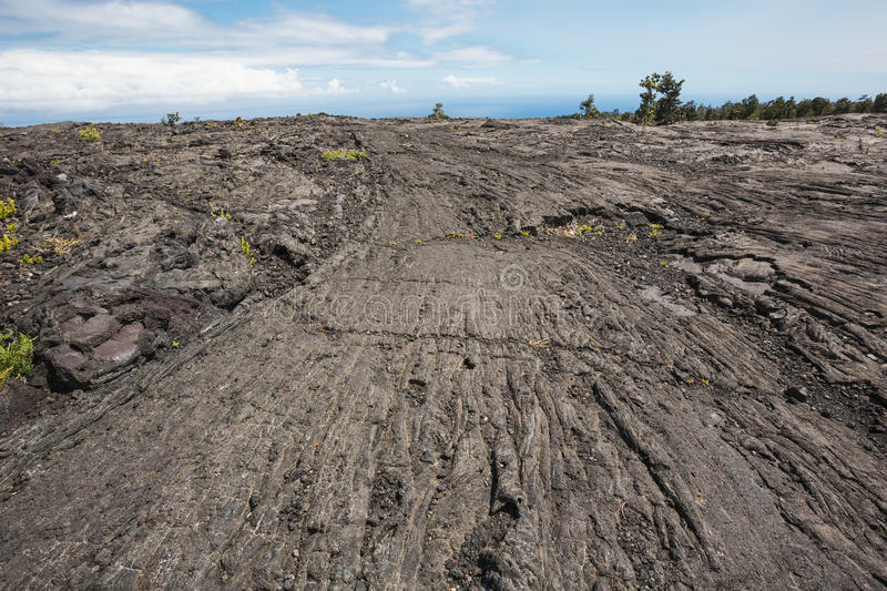 Pahoehoe lava leading to the horizon. The ropy structure creates lines that lead to the horizon stock photos
