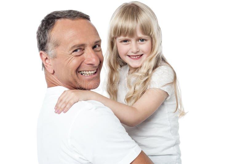 Pai alegre com a filha pequena bonito imagem de stock royalty free