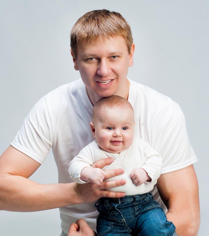 Pai com bebês fotos de stock