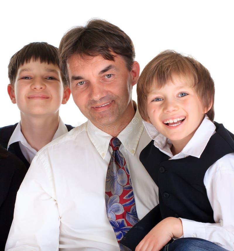 Pai com filhos fotografia de stock
