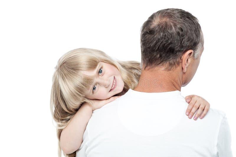 Pai e filha em um fundo branco imagens de stock