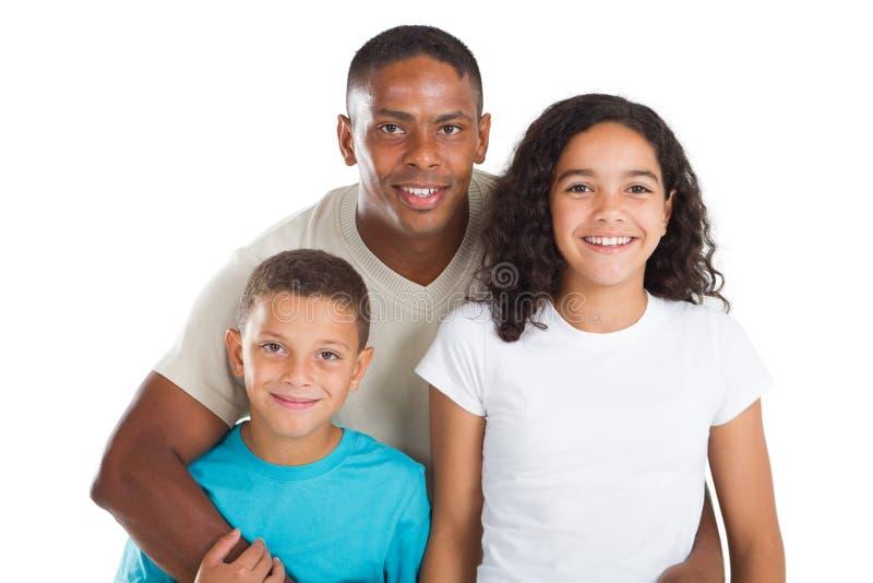 Pai e miúdos imagem de stock
