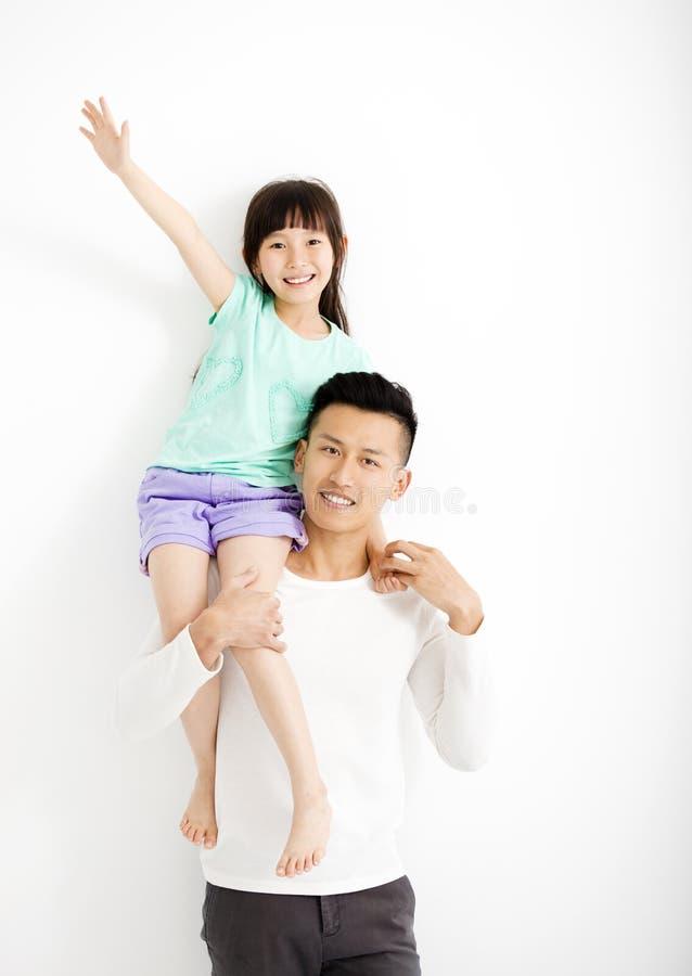 Pai feliz e filha que têm o divertimento junto foto de stock royalty free