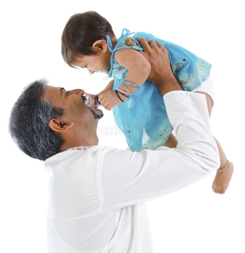 Pai que joga com filha fotografia de stock