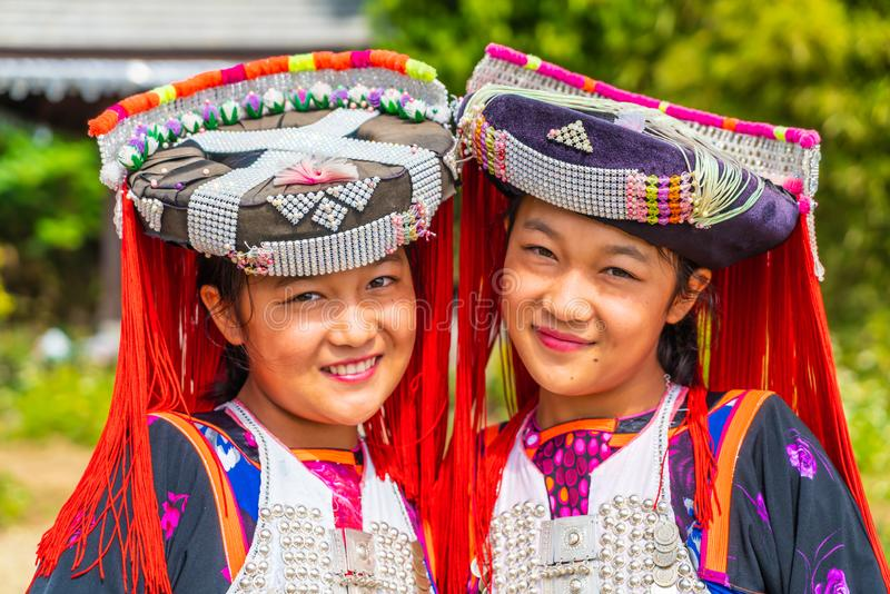 PAI, THAILAND - FEB 16, 2019 : Hmong children with nasal mucus,Portrait of H'mong(Miao) little girls wearing traditional dress. During Lunar New Year holiday stock photography
