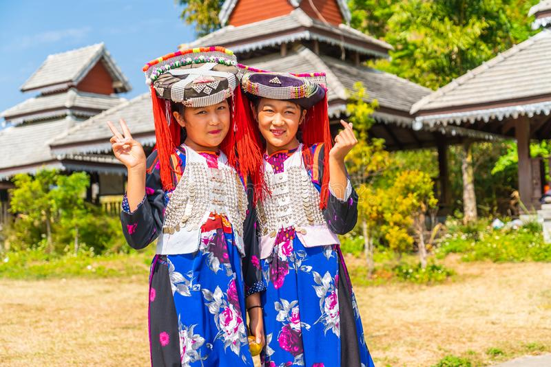 PAI, THAILAND - FEB 16, 2019 : Hmong children with nasal mucus,Portrait of H'mong(Miao) little girls wearing traditional dress. During Lunar New Year holiday stock image