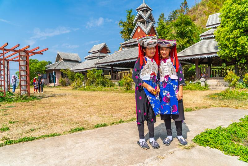 PAI, THAILAND - FEB 16, 2019 : Hmong children with nasal mucus,Portrait of H'mong(Miao) little girls wearing traditional dress. During Lunar New Year holiday stock images