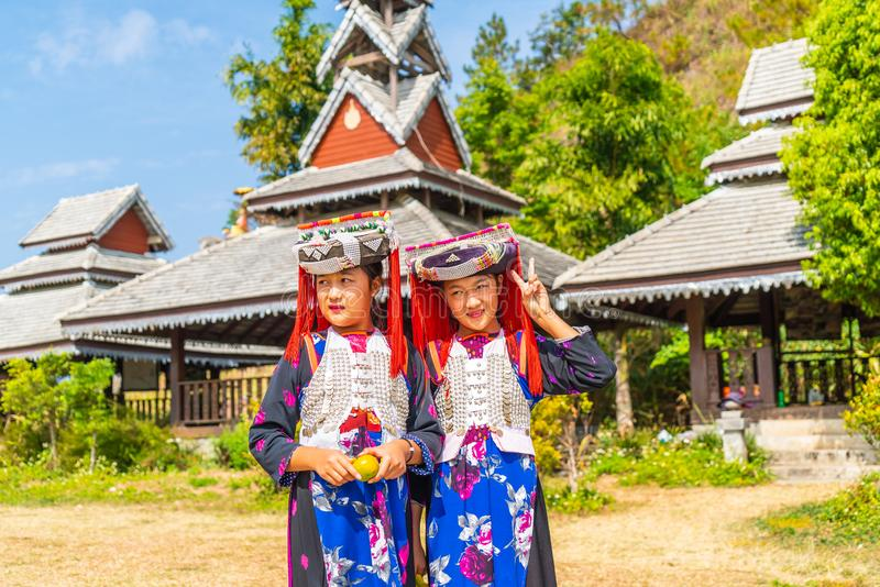 PAI, THAILAND - FEB 16, 2019 : Hmong children with nasal mucus,Portrait of H'mong(Miao) little girls wearing traditional dress. During Lunar New Year holiday royalty free stock photography