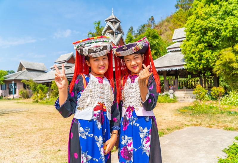 PAI, THAILAND - FEB 16, 2019 : Hmong children with nasal mucus,Portrait of H'mong(Miao) little girls wearing traditional dress. During Lunar New Year holiday royalty free stock photos