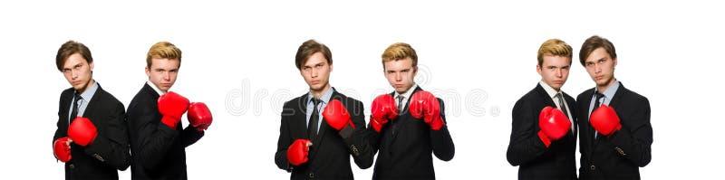 Paia degli uomini d'affari che inscatolano sul bianco fotografia stock