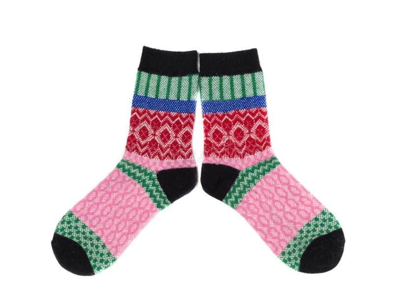 Paia dei calzini a strisce colorati, isolato su un bianco immagine stock libera da diritti
