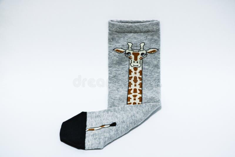 Paia dei calzini variopinti, isolate su fondo bianco immagini stock libere da diritti