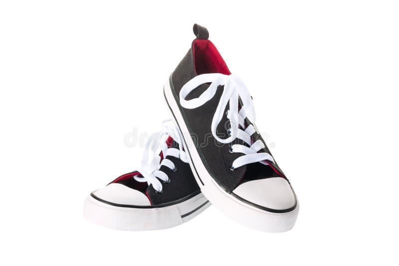 Paia di nuovi scarpe da tennis o gumshoes dei keds isolati su fondo bianco fotografie stock